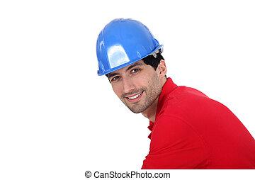 Man wearing a blue hardhat