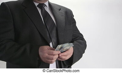 Man wearing a business suit counting hundred dollar bills