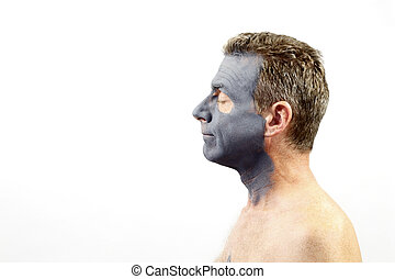 Man Wearing a Charcoal Bentonite Mask