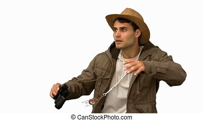 Man wearing a coat using binoculars on white screen in slow...