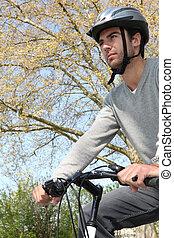 Man wearing a helmet on his bicycle