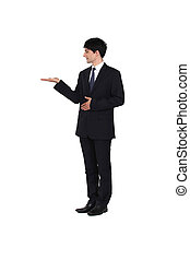 Man wearing a suit and presenting his right hand