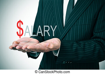 salary - man wearing a suit holding the word salary in his...