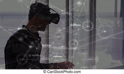 Man wearing a virtual reality with graphs