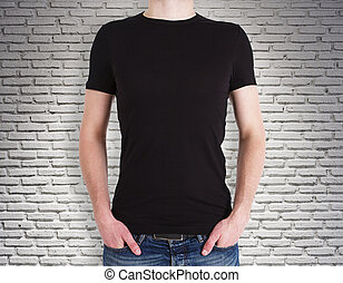Man wearing black shirt on brick background