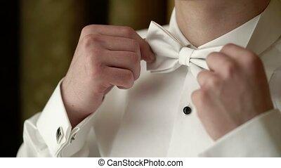 Man wearing bowtie closeup shot