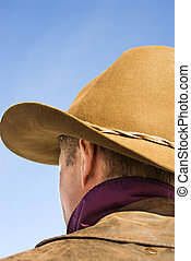 Man wearing cowboy hat. - Back of a Middle-aged Caucasian...