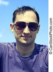 man wearing creative fashion sunglasses