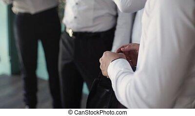 Man wearing cufflinks with friends - Man wearing cufflinks...