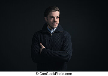 Man wearing dark blue winter sweater and blue shirt.