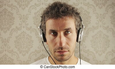 man wearing different retro headphones