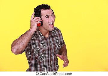 Man wearing ear defenders