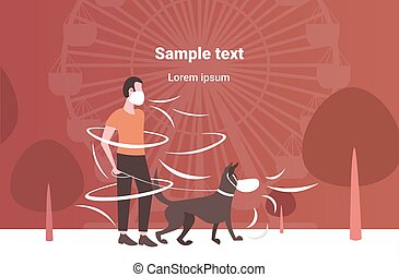 man wearing face mask walking with dog toxic air pollution industry smog polluted environment concept guy with pet animal standing outdoor ferris wheel background full length horizontal copy space