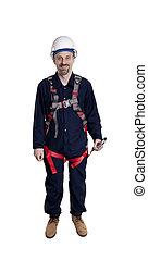 man wearing fall protection - Man wearing fall protection...