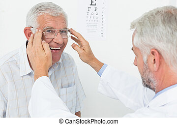 Man wearing glasses after taking vision test at doctor - ...