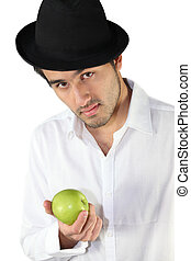 Man wearing hat and holding apple