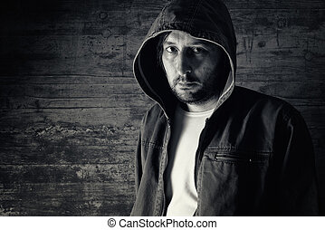 Man wearing jacket with hoodie