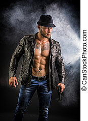 Man wearing leather jacket on naked muscular torso
