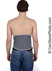 Man wearing lumber support belt. - Lumber support belt worn...