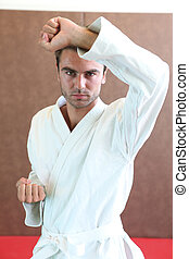 Man wearing martial arts clothing stood in defense stance