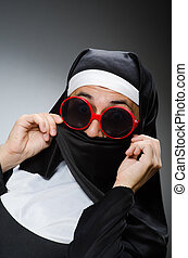 Man wearing nun clothing in funny concept