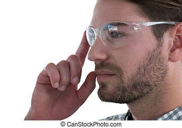 Man wearing protective glasses