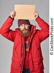 Man wearing red winter Alaska jacket  with fur hood on