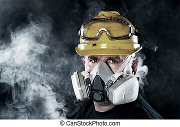 Man wearing respirator - A rescue worker wears a respirator...