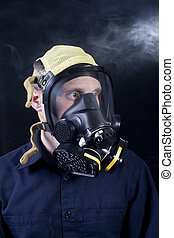 gas mask - man wearing respirator or gas mask while exposed...