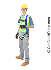 Man Wearing Safety Climbing Harness - A construction worker...