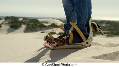 Man wearing sandals in the desert 4k - Close-up of man...