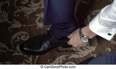 Man wearing shoes close up