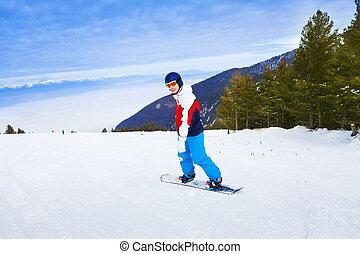 Man wearing ski mask standing on snowboard