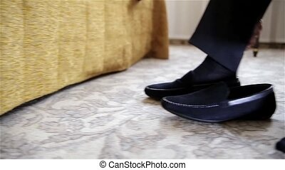 Man wearing stylish shoes - A man in white shirt looking as...