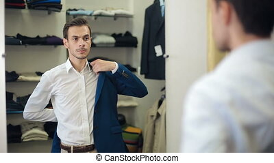 Man wearing suit at clothing store