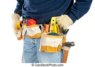 Man wearing tool belt - A skilled tradesman stands with his ...