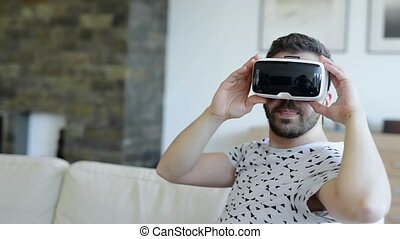 Man wearing virtual reality goggles. Studio shot, white...