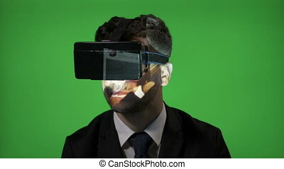 Man wearing virtual reality goggles to scroll on his social...