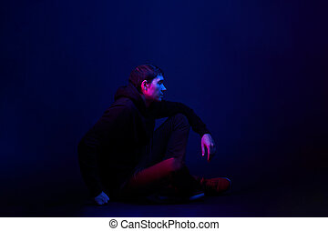 Man sit on blue background