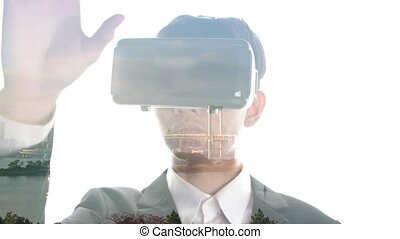 Man wearing VR glasses watch Tokyo skyline movie presented in double exposure effect on bright background . Virtural reality experience concept .