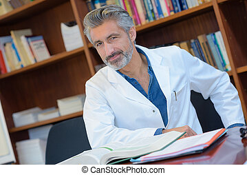 man wearing white coat in the library