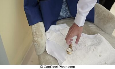 Man wearing wrist watch - Man wearing golden wrist watch