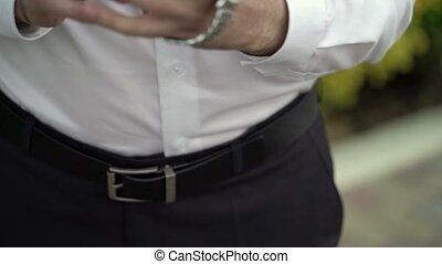 Man wearing wrist watches outdoors