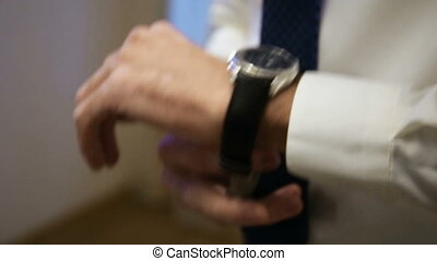 Man wears a watch on his arm.