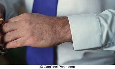Man wears wrist watch - Unrecognizable young man wears wrist...