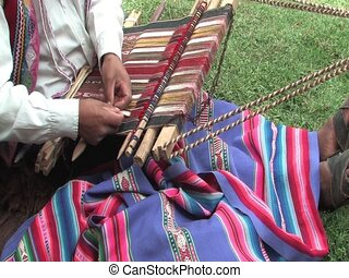 weaving - Man weaving a rug in Peru