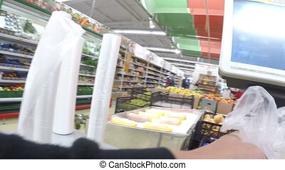 man weighing products in the store in the first person on...