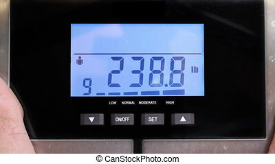 Man weighs self scale says ouch - man weighs himself and...