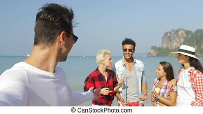 Man Welcome People Group To Take Selfie Photo On Beach On...