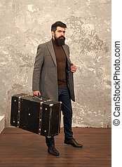 Man well groomed bearded hipster with big suitcase. Travel and baggage concept. Hipster traveler with baggage. Ready for relocation with baggage. Start journey. On way to new life. Luggage insurance